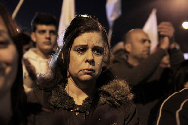 CYPRUS, Nicosia : A woman sheds tears during a protest infront of Presidential Palace in the Cypriot capital Nicosia on March 27, 2013.