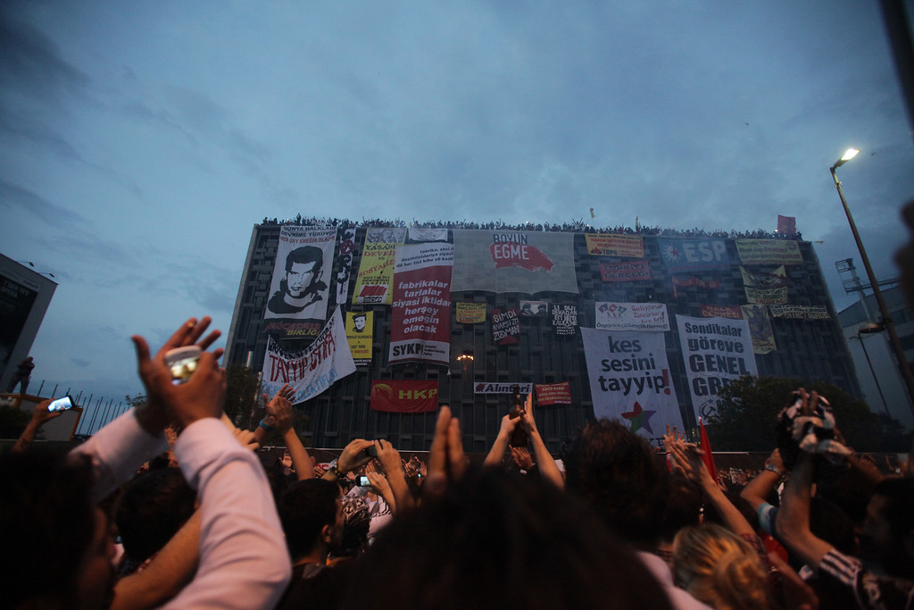 June 04,2013- Istanbul,Turkey: Protestors shout slogans in Taksim Square on June 4, 2013 in Istanbul, Turkey.The protests began initially over the fate of Taksim Gezi Park, one of the last significant green spaces in the center of the city.