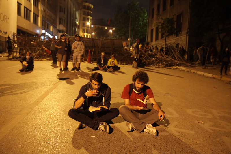 June 04,2013- Istanbul,Turkey:  Protestors read books in Taksim Square on June 4, 2013 in Istanbul, Turkey.The protests began initially over the fate of Taksim Gezi Park, one of the last significant green spaces in the center of the city.