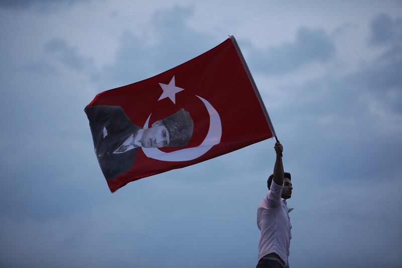 June 04,2013- Istanbul,Turkey:A Protestor waves a Turkish flag  in Taksim Square on June 4, 2013 in Istanbul, Turkey.The protests began initially over the fate of Taksim Gezi Park, one of the last significant green spaces in the center of the city.