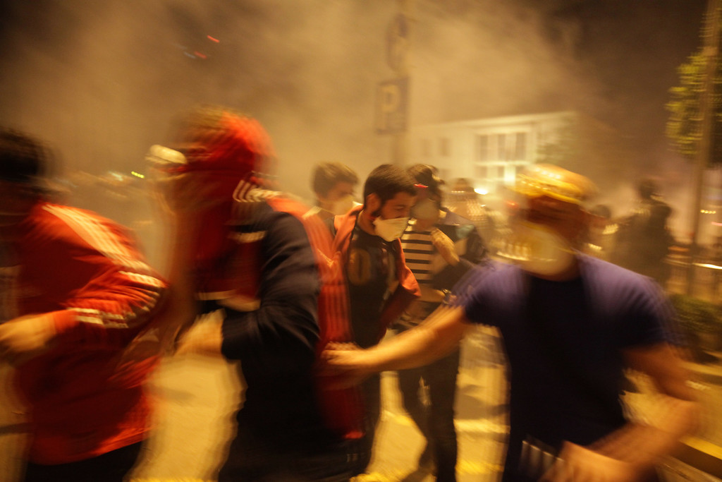 June 05,2013- Istanbul,Turkey:  Protestors clash with the police on June 5, 2013 in Istanbul, Turkey.The protests began initially over the fate of Taksim Gezi Park, one of the last significant green spaces in the center of the city