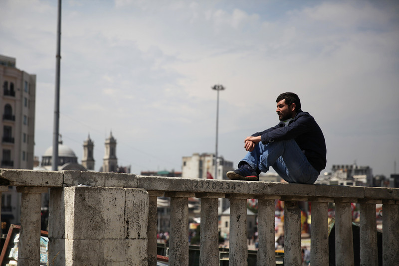 June 05,2013- Istanbul,Turkey:  A man sits alone  in Taksim Gezi park.The protests began initially over the fate of Taksim Gezi Parhek, one of the last significant green spaces in the center of the city.