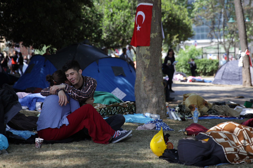 June 05,2013- Istanbul,Turkey:  A couple hug in Taksim Gezi park.The protests began initially over the fate of Taksim Gezi Parhek, one of the last significant green spaces in the center of the city