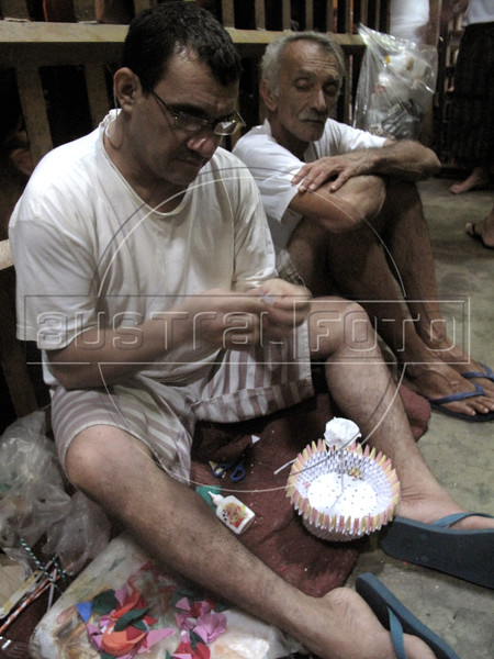 Prisoners make arts and crafts at a police station jail in Sao Goncalo, a working class suburb of Rio de Janeiro. Brazilian jails and prisons, where inmates are separated by gang allegiance, are notoriously overcrowded. The sub-human conditions which are criticized by human rights groups are also one of the principal causes of prison riots in the South American Nation. (Australfoto/Douglas Engle)