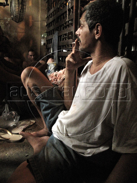 Prisoners at a police station jail in Sao Goncalo, a working class suburb of Rio de Janeiro. Brazilian jails and prisons, where inmates are separated by gang allegiance, are notoriously overcrowded. The sub-human conditions which are criticized by human rights groups are also one of the principal causes of prison riots in the South American Nation. (Australfoto/Douglas Engle)