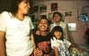 "Francisco Valladares, known as ""Demonio,"" relaxes with his cousins in San Salvador, El Salvador. Valladares, 22, has been in the Mara Salvatrucha 13, a gang started in Los Angeles in the 1970's by Salvadoran immigrants, since he was 12. (AustralFoto/Douglas Engle)"