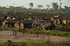 Members of the Landless Workers Movement (MST) play soccer in front of their thatched huts on the Peruano ranch, owned by Evandro Mutran, south of Maraba, in Brazil's Amazonian state of Para, Oct. 5, 2004. The workers, which squat on land to pressure the federal government, demand expropriation of the land due to several irregularities. The Brazilian Federal government expropriated another ranch owned by the Mutran family, the Castanhal Cabaceiras ranch, in October 2004, to use for agrarian reform. According to the Labor Ministry, the owner used slave labor, whose officials found it on four separate auditory raids. This is the first time land has been confiscated due to slave labor. The Mutrans are also accused of cutting down the rainforest and annexing land illegally through the use of false documents. The expropriated ranch is 9.7 thousand hectares, which will be divided between 250 families.(Australfoto/Douglas Engle)