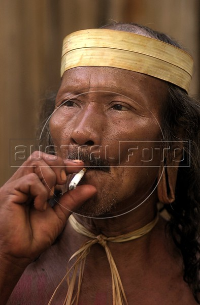 A member of the Kraho tribe smokes during a meeting with visitors at the Museum of the Indian in Rio de Janeiro,  Brazil, Sunday, April 16, 2000. Several Kraho, from Brazil's northern Toncantins state were at the museum to speak with vistors as part of festivities for Brazil's 500th anniversary, April 22.(Australfoto/Douglas Engle)