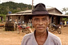 """Rural worker Jose Maria in the new settlement of Novo Horizonte in the """"Terra do Meio"""" or Middle Lands, in the municipality of Sao Felix do Xingu in Brazil's Amazonian state of Para. Named for the area between the Xingu and Iriri Rivers, the 29,343 sq. mile area (slightly smaller than Maine or Scotland) lies in the path of progress as cattle ranches encroach from the east and big business soy advances from the south. illegal logging, labor, land-grabbing and human rights abuses in the area are not uncommon. Simple people, looking for opportunity to have some cheap land, are migrating to the reagion. Much Like the favelas of Rio de Janeiro, which were not officially included on city maps until the mid-1990s, the Middle Land is also a species of autonomous zone - a black hole of information and uncertainty over which Brazilian authorities in reality have little control. (AustralFoto/Douglas Engle)"""