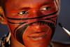 A Pataxo Indigneous man gets his face painted before the closing ceremony of the XII annual Indigenous games in Porto Seguro, Bahia state, Brazil, Nov. 27, 2004. About 1,100 members of 42 tribes are participating in the games.(Australfoto/Douglas Engle)