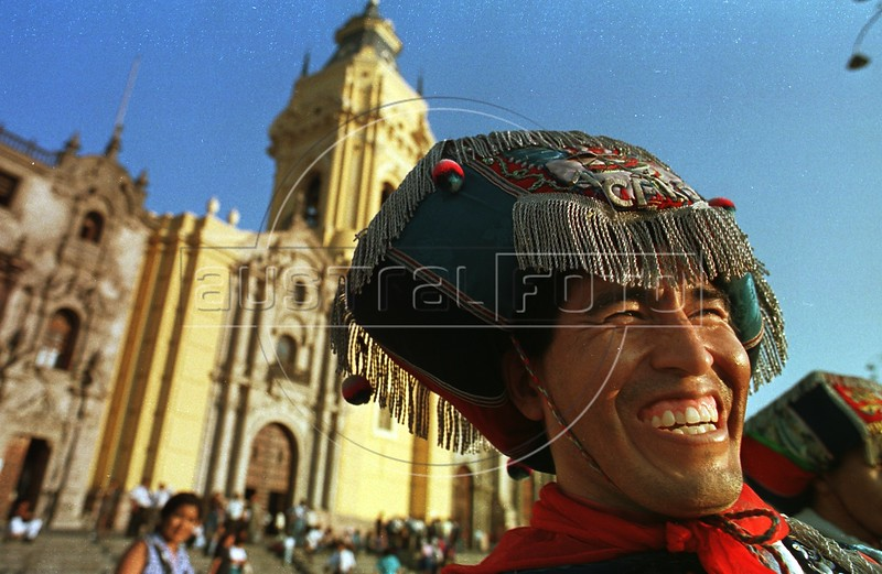 An Indian man from Huancavelica smiles during a cultural ceremony in the main plaza of Lima, Peru, Tuesday, April 15, 1997. Hundreds converged on the plaza performing dances and music.(Australfoto/Douglas Engle)