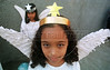 Chayane da Silva, nine, poses in her angel outfit in Sao Goncalo, about 15 miles east of Rio de Janeiro, Brazil, Thursday, June 3, 1999. Da Silva and other young girls dressed as angels to participate in the Corpus Christi procession, which ended at the church with a Mass. The traditional Mass re-affirms the Catholic belief in the eucharist: bread and wine as the symbol of Christ's body and blood.(Douglas Engle/Australfoto)