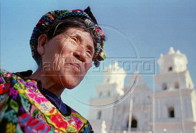 "ADV. FOR MON. AMS, JAN. 29--A woman from Concepcion Chiquirichapa, Guatemala, identified by her blouse, stands in front of the Basilica in Esquipulas, Guatemala, January 15,1996. Thouands of pilgrims descended on the town in eastern Guatemala to pay respcts to the ""Black Christ,"" which is said to have miraculous powers.(Australfoto/Douglas Engle)"