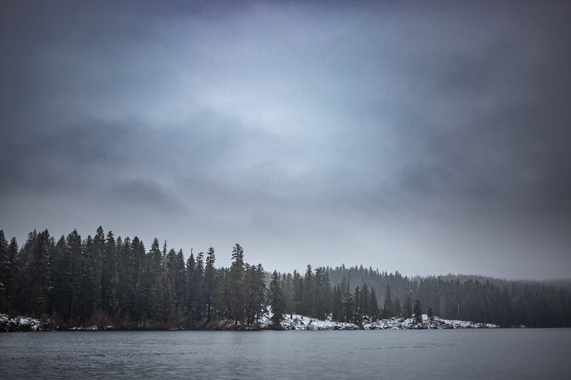 Rain falls at a snowy Clear Lake in April. Clear Lake is the beginning of the McKenzie River. The McKenzie River benefits farmers and other families along the McKenzie Valley as well as provides all drinking water for Eugene.