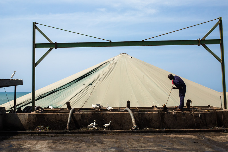 A worker at Bola Boden prepares the facility for incoming waste. Bola Boden transforms human waste into organic fertilizer. On top of the creation of fertilizer, this process improves the sanitation around the area.
