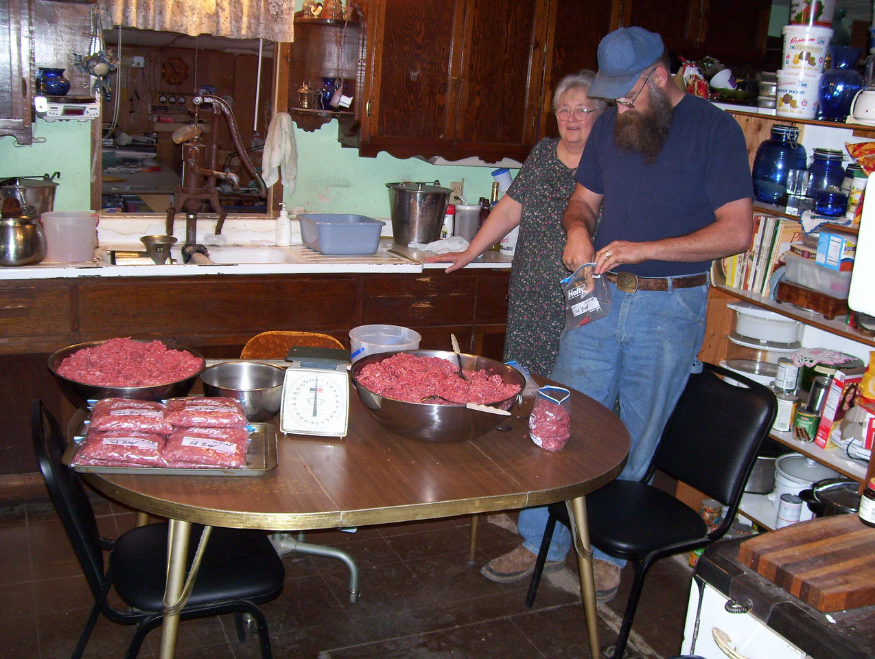 20-- Bagging up  Delicious.<br /> After the meat cools down, the next morning we can grind it up and end up with 3 big pans to weigh out into freezer bags to go into the freezer until it is used. We keep Kathy busy marking the dates on the bags and putting it away and also the cleanup.