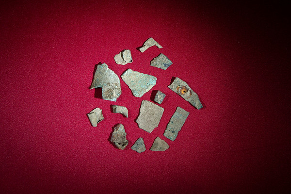 Fragments of bronze and lead discovered in the Vagnari vicus excavation.