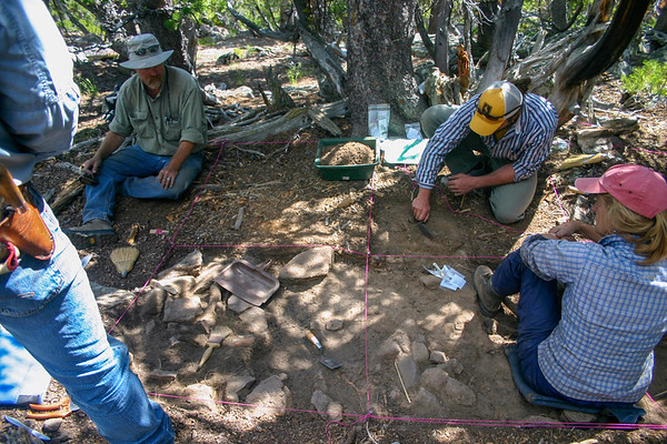 Dr. Richard Adams and Dr. Bryon Schroeder excavate a lodge pad at High Rise Village that contained over 10,000 chipped stone artifacts.
