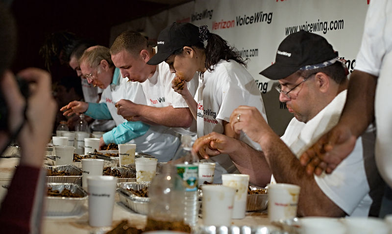 "<p class=""clear_paragraph""> This afternoon, Boston hosted a championship eating contest. <p> The format of this event is: <ol type-1> <li>The contest takes 10 minutes. <li>The goal is to eat as much chicken as possible within the time limit. <li>The contestents are given trays of chicken wings carefully weighed to exactly 3 lbs each. <li>At the end the trays (with the bones) are weighed. <li>Score = (3 x number of trays) - residual weight </ol>  This event is big league competitive eating. The contestents qualified during October in three different lesser events in Seatle, San Francisco, and Washington, DC."