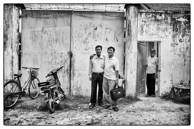 """Ouk and the head of the prison ask me to take a photo of them. Personal relationships are extremely important in places like Cambodia, where the rules and the """"law"""" are much more flexible."""