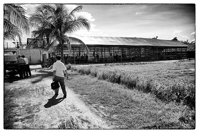 Ouk makes his way towards a prison in Pursat. He visits prisons to identify and interview prisoners that are languishing in prison without access to a lawyer. Most Cambodians can't afford a lawyer. He finds many more cases than he can handle. Poverty is compounded when a man or woman is arrested and sits in prison for months and years awaiting a trial as the family, usually living day by day, loses an income. Prisoner's  families must also spend money and time bringing them food, as none is provided.