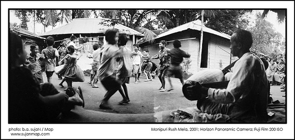 Rash Mela festival is one of the most colorful festivals in November celebrated by the beautiful Manipuri tribes in Kamalgong, Moulavibazar area! This Hindu festival dedicated the love of Krishna and Radha.    It has a lot of interesting rituals and the festival begins from their house yards where the little kids dressed like Krishna and start dancing, collecting the offering. Afternoon in the open ground, people will gather and made several temples by banana tree and dance around the temple. Other people will through the offering. It's the last daylight in the open air, it looks fabulous. In the late evening in the central temple, beautifully dressed girls will start dancing in their traditional style. Collected.  Photo: Bashir Ahmed Sujan Freelance Photographer Map Photo Agency, Dhaka, Bangladesh.