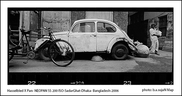 Volkswagen Beetle the vintage car abandoned on the street in old Dhaka, Bangladesh.