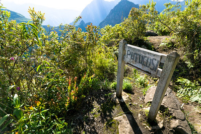 A sign marking the top of Putucusi trail.