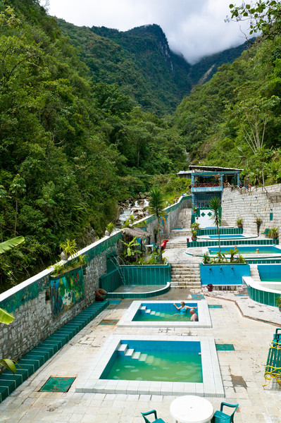 """The natural hot spring which gives Aguas Calientes (""""Hot Waters"""") its name is a good 10 minute hike north of town (3 dollar entry fee). Forgot your swimsuit? No problem, many shops will happily rent you one and a towel at the entrance for a few dollars. There is also a bar that serves beer and all types of mixed drinks, bringing them right to you in the water."""