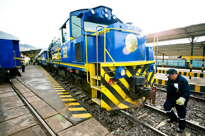 """The """"Backpacker"""" train run by PeruRail gets ready to leave San Pedro station in Cuzco for the 4 hour journey to the village of Aguas Calientes, also known as Machu Picchu Pueblo."""