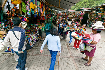 In order to exit the train station passengers must navigate through a dizzying labyrinth of handicraft tourist stalls.