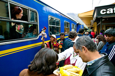 Locals sell alpaca tourist products and food to passengers on the train at Ollantaytambo, one of the few stops along the way.