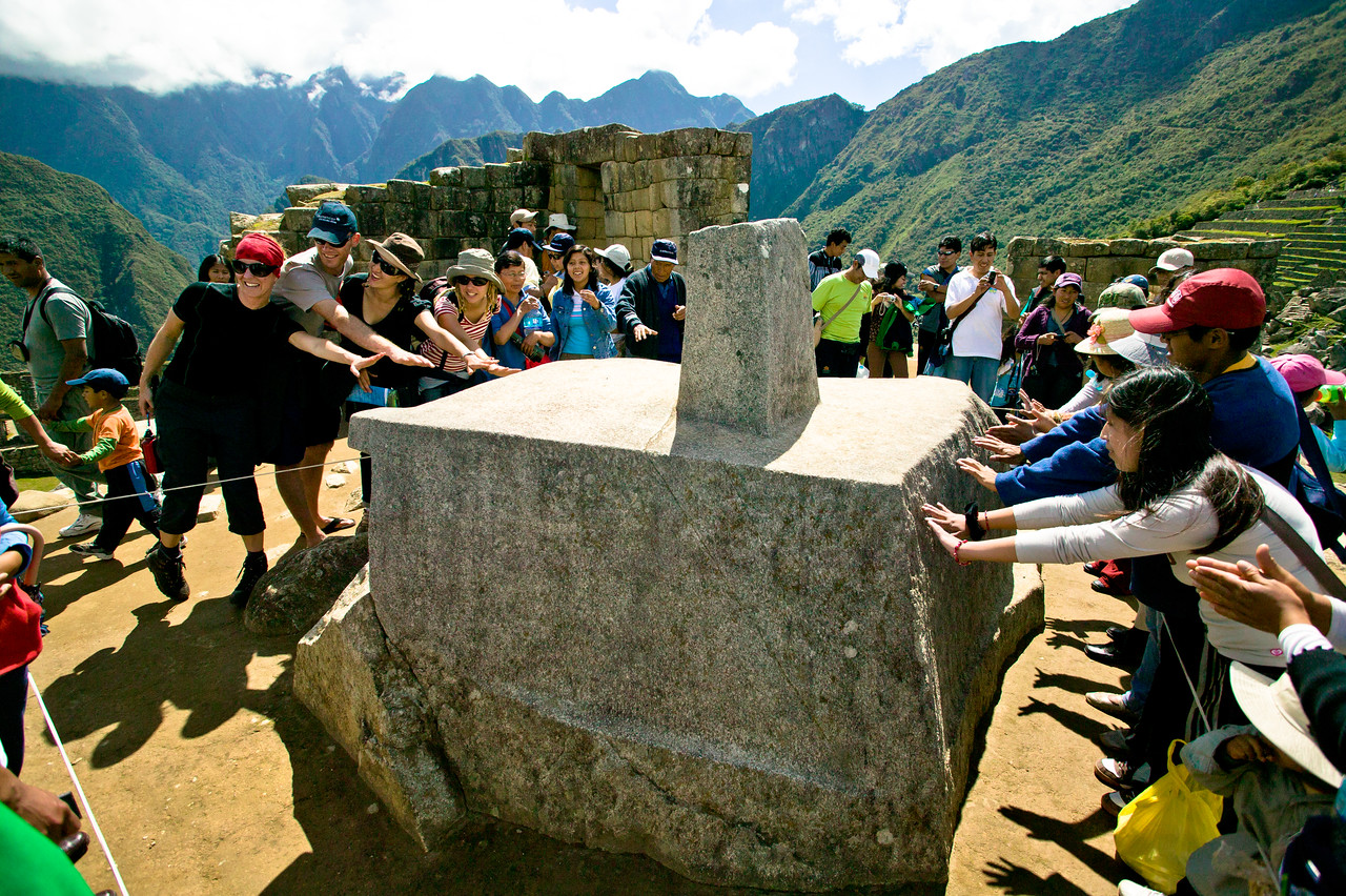 "Visitors at Intiwatana, or ""hitching post of the sun,"" aren't allowed to touch the sacred stone but are instead invited to feel the rock's energy by hovering their hands over it. Oriented to the four cardinal points, the shadow cast by the Intiwatana was used to predict the solstices, very important dates for the Inca. This is the only one of its kind not destroyed by the Spanish conquerors, who made a point of destroying all things dealing with Incan religion. However, it was damaged in 2000 when a 1,000 pound mechanical arm used during a Peruvian beer commercial toppled into it breaking off a small chunk (it has since been repaired but a visible crack where it was fixed remains)."