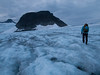 Crossing the glacier at the meeting of the Leirbrean glacier (left) and Smørstabbrean glacier (right), heading towards Kalven mountain. Saksa mountain in the distance. Jotunheimen National Park. Norway.