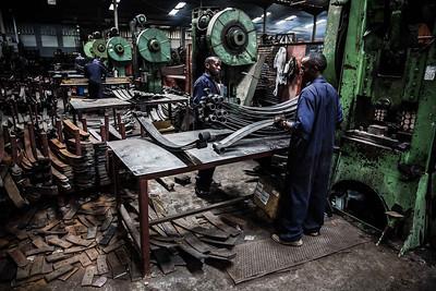 Workers bend steel to make leaf springs in Nairobi.