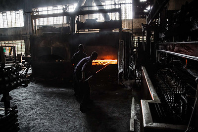 Workers heat steel to make leaf springs in Nairobi.
