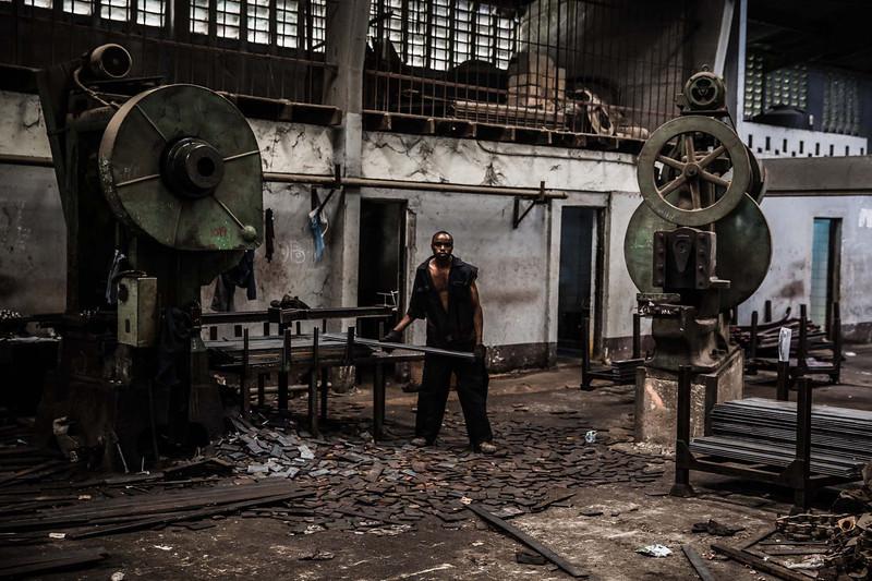 Workers cut steel to make leaf springs in Nairobi.