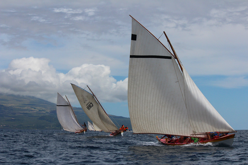 Whaleboats race in the Semana do Mar regatta. A cultural renaissance surrounding the whaleboats has transitioned them from hunting vessels to ones used for sport among the younger generation.