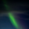Northern Lights shafts through the clouds