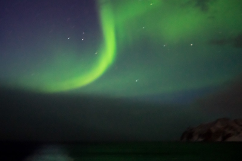 Northern Lights turn the sea green