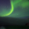 Northern Lights turn the sea green