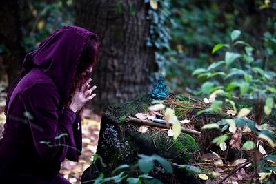 Ilenya praying in the woods