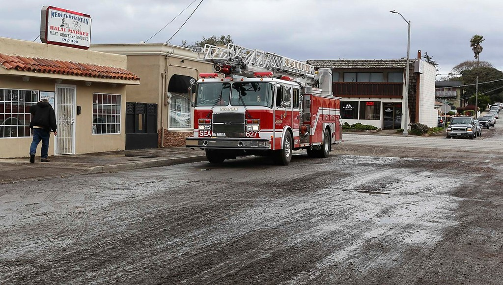 . Seaside Fire Department responds to Halal Market on Hamilton St. as it was flooded during the overnight storm on Sunday, January 8, 2017 in Seaside, Calif. (Vernon McKnight/Herald Correspondent)