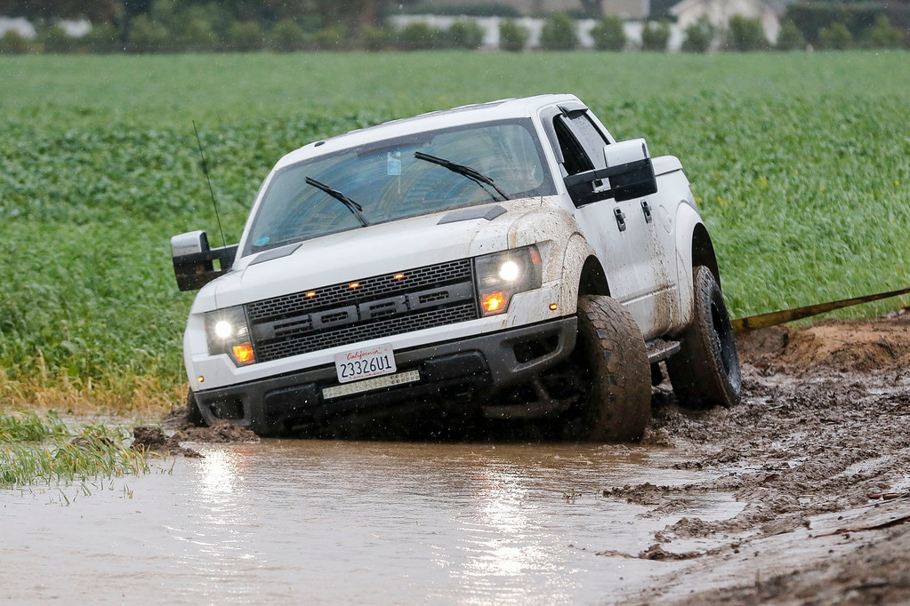 . A motorist stuck in the mud in a field on San Juan Grade Rd. is pictured during a downpour of rain on Sunday, January 8, 2017 in Salinas, Calif. (Vernon McKnight/Herald Correspondent)