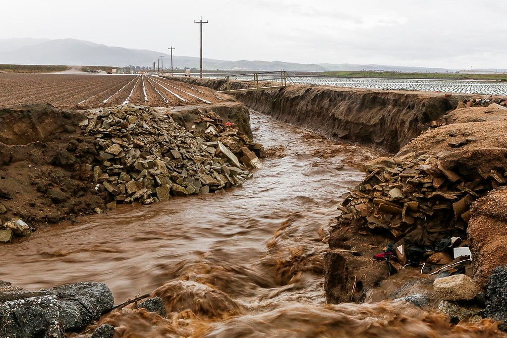 . Rain water flows down a creek between two agriculture fields located on Alisal Rd. on Sunday, January 8, 2017 in Salinas, Calif. (Vernon McKnight/Herald Correspondent)