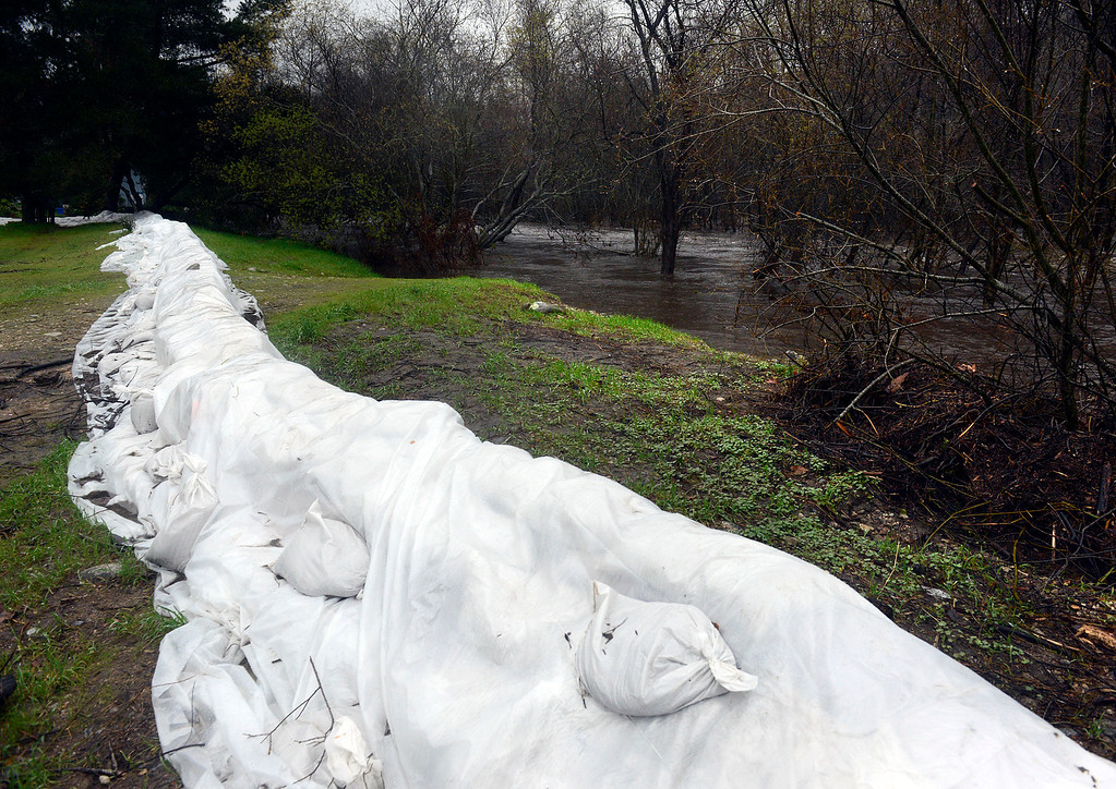 . The Carmel River rises below Sandbags on the east side of Dampierre Park Paso Hondo neighborhood in Camel Valley on Tuesday afternoon February 7, 2017. (David Royal - Monterey Herald)