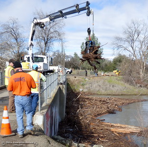 Butte County Public Works crew tires to remove a huge patch of wood and debris from behing the outlfow in the dam on Rio Lindo Channel adjacent to the disk golf course at Hooker Oak Recreation Area Wed. Jan. 11, 2017. (Photos contributed by Roger Aylworth)