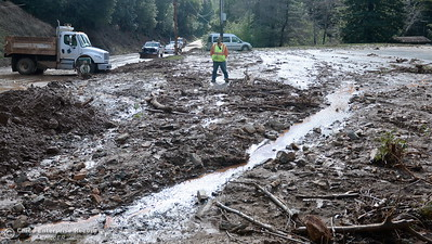 Butte County Public Works Road Maintenance Supervisor Jason Gangelhoff keeps an eye on things at right as crews work to clear a mudslide on hwy 162 near Berry Creek Wed. Jan 11, 2017. (Bill Husa -- Enterprise-Record)