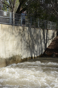 Landon Brownfield, 17, takes a picture of the a raging Big Chico Creek from the dam a Five-Mile Recreation Area on Wednesday, Jan. 11, 2017, in Chico, California. (Dan Reidel -- Enterprise-Record)