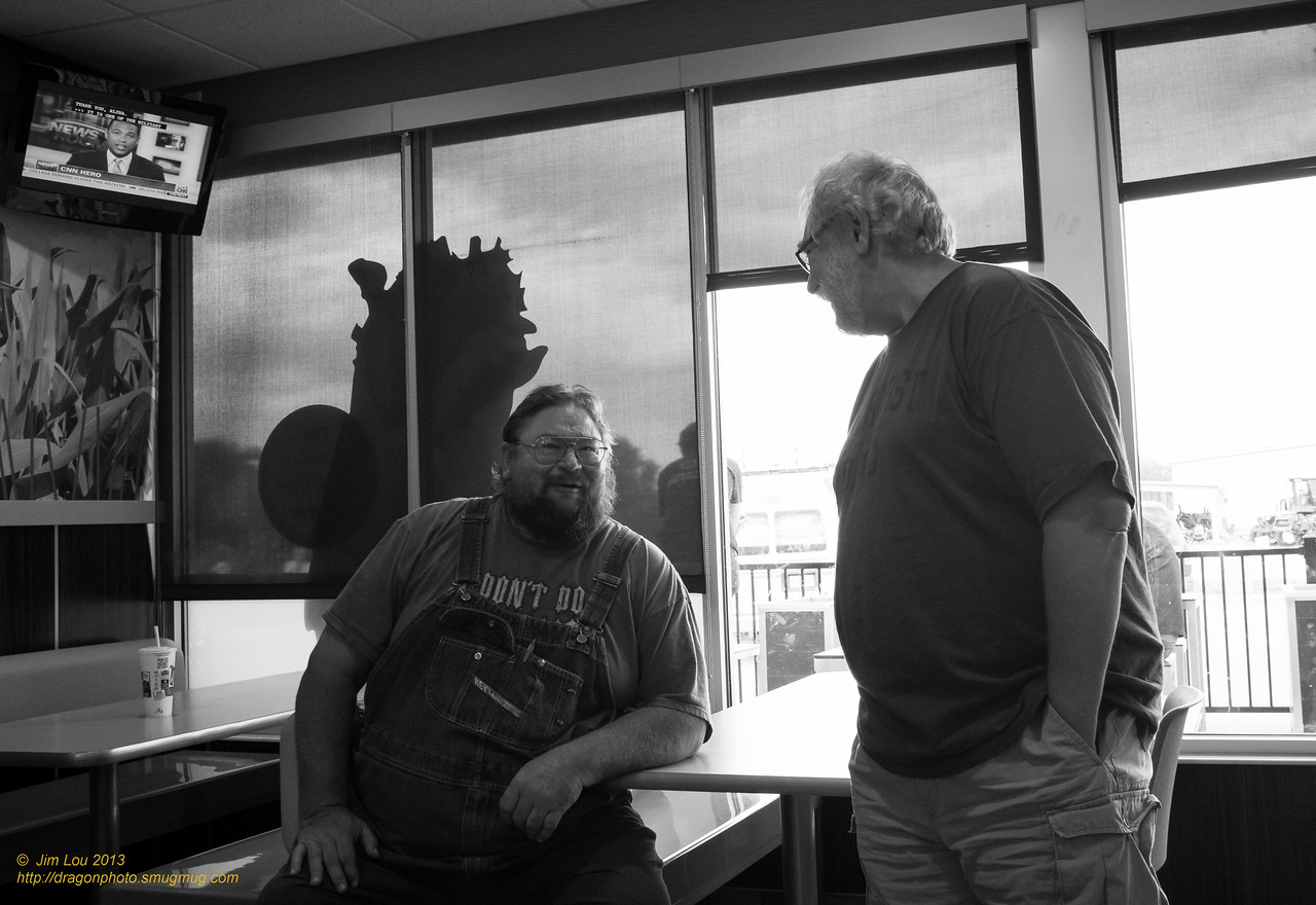 Art(Heather's Dad who is on the right) chatting with a local during afternoon snack at a McDs.